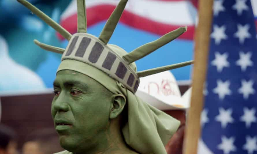 Person dressed as the Statue of Liberty participates in an immigrant rights march in May 2006 in Chicago