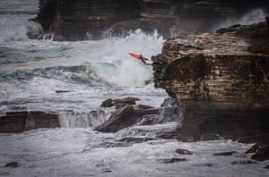 Sydney, Australia A surfer jumps off rocks into the sea at Warriewood Beach. The Bureau of Meteorology has issued a severe weather warning for Sydney and large parts of coastal NSW