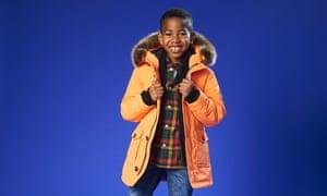 A boy in a Superdry jacket