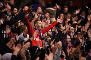 PSG's supporters cheer prior to the UEFA Champions League Group match against Liverpool.