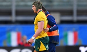 The injured David Pocock of Australia is helped from the pitch after 51 minutes of their 26-7 win over Italy in Padova.