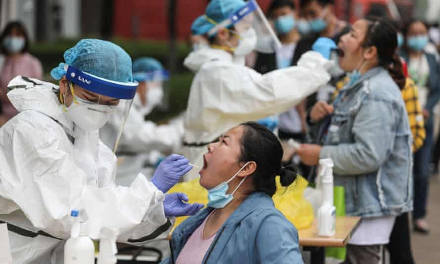 Open-air coronavirus testing gets under way in Wuhan, Hubei province.