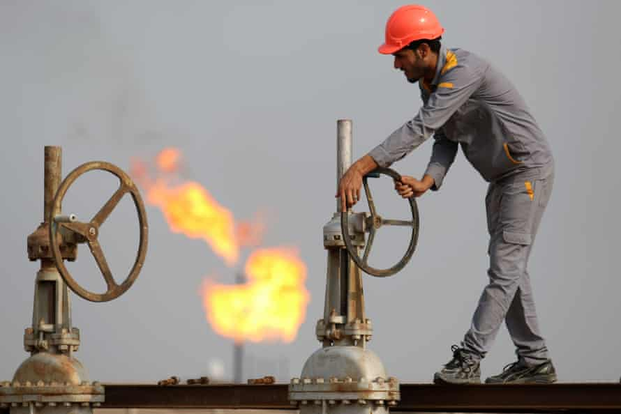 An Iraqi labourer works at an oil refinery in the southern town of Nasiriyah.