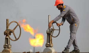 An Iraqi labourer works at an oil refinery
