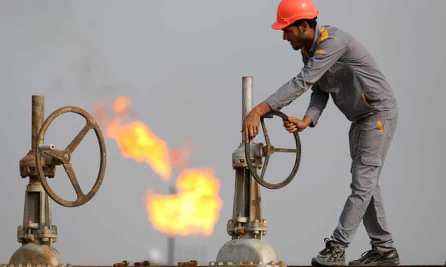 An Iraqi labourer works at an oil refinery