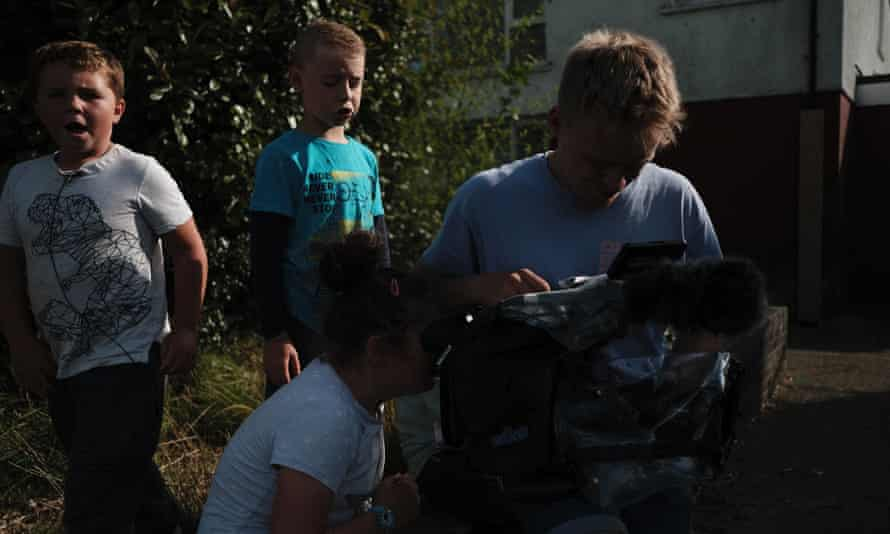 Children watching the monitor on the set of No Ball Games