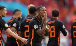 Netherlands' midfielder Georginio Wijnaldum (L) celebrates scoring his team's third goal.