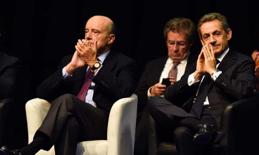 Alain Juppé (left) and Nicolas Sarkozy looking on in Limoges.
