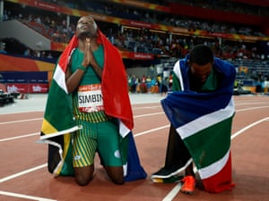 South African gold medalist Akani Simbine and silver medalist Henricho Bruintjies savour the moment.