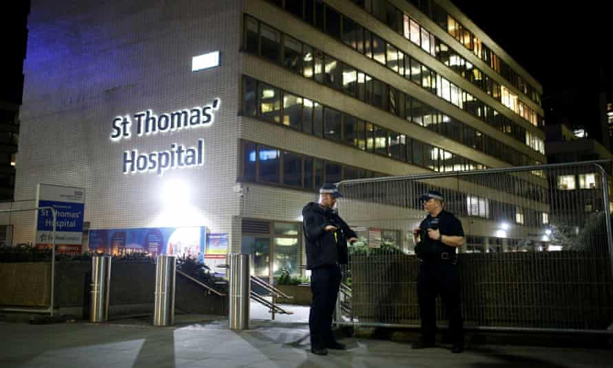 Police officers outside St Thomas' hospital after Boris Johnson was moved to intensive care.