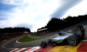 Lewis Hamilton drifts onto a kerb at the edge of the track