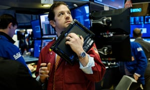 Traders on the floor of the New York stock exchange as US markets slide