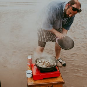 Chef Charlie Hodson cooking on a sandbank off the Norfolk coast.
