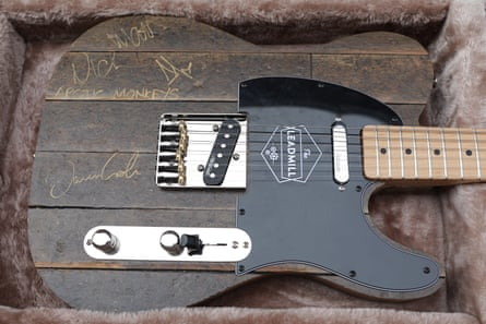 A guitar made from Leadmill floorboards, and signed by the Arctic Monkeys, raised £7,200.