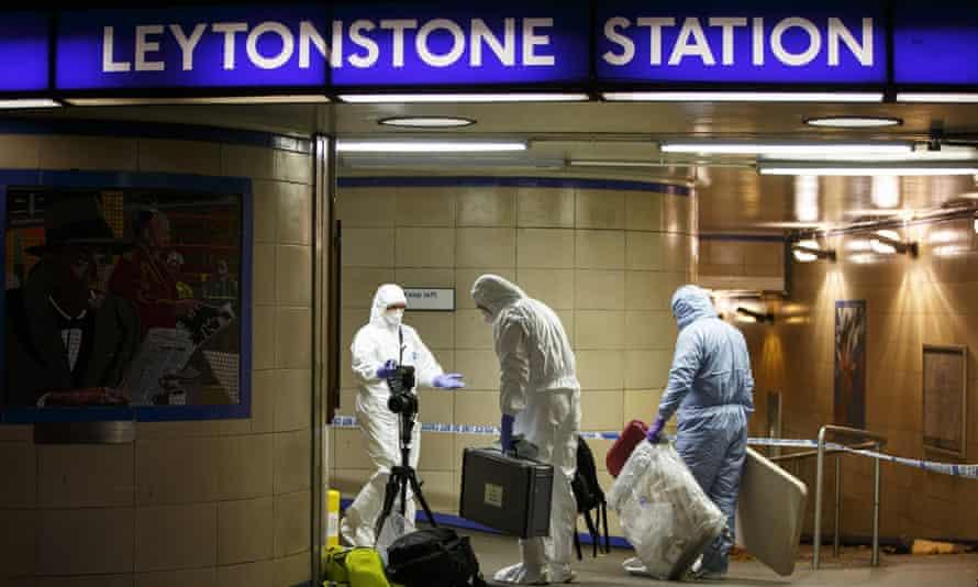 Police and crime scene investigators at Leytonstone tube station