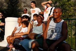 Residents of Pereira da Silva favela watch their children playing with Favela Brass
