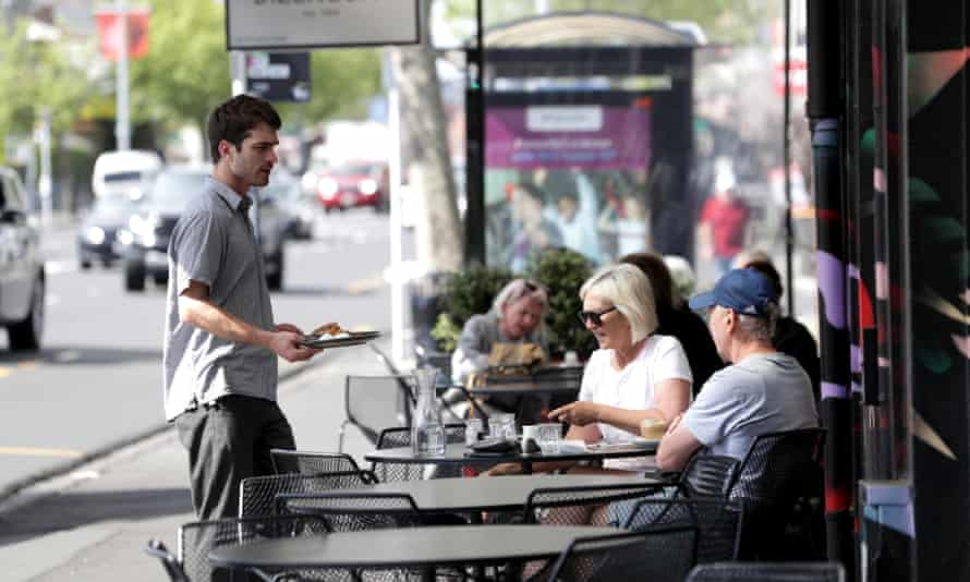 People sit outside cafes in auckland, new zealand