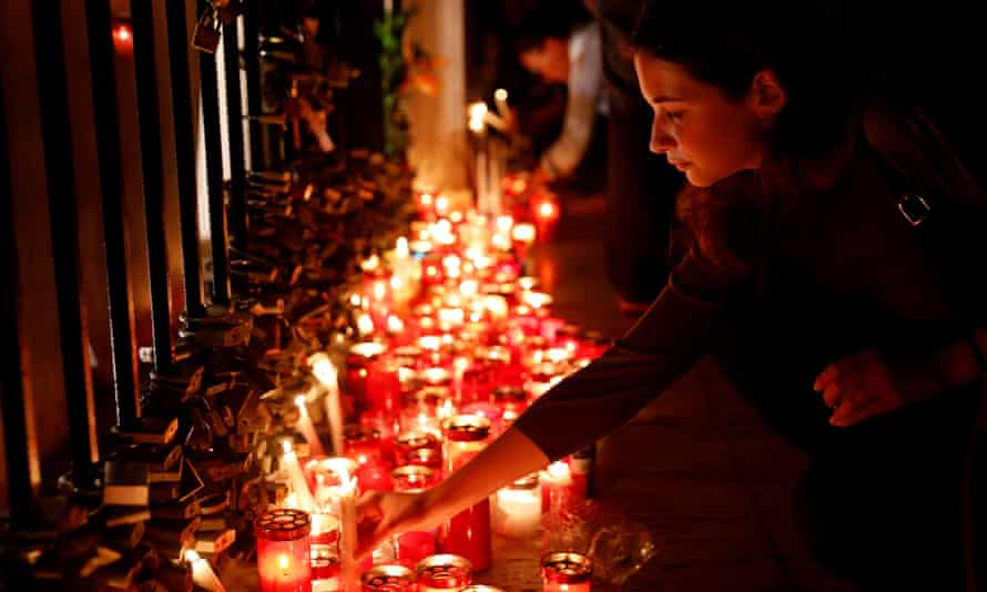 Candles are lit at a vigil to protest against Caruana Galizia's death.