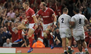 George North celebrates scoring for Wales with his captain, Alun Wyn Jones, at Cardiff on Saturday.