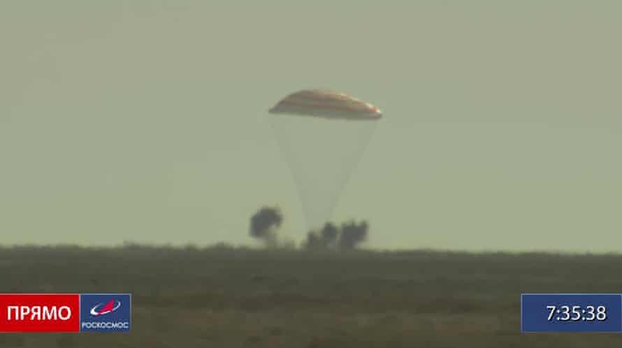 The Soyuz MS-18 space capsule lands in a cloud of dust in Kazakhstan.
