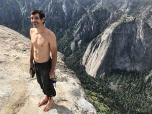 Alex Honnold holds all of his climbing gear on the summit of El Capitan after becoming the first person to climb it without a rope.