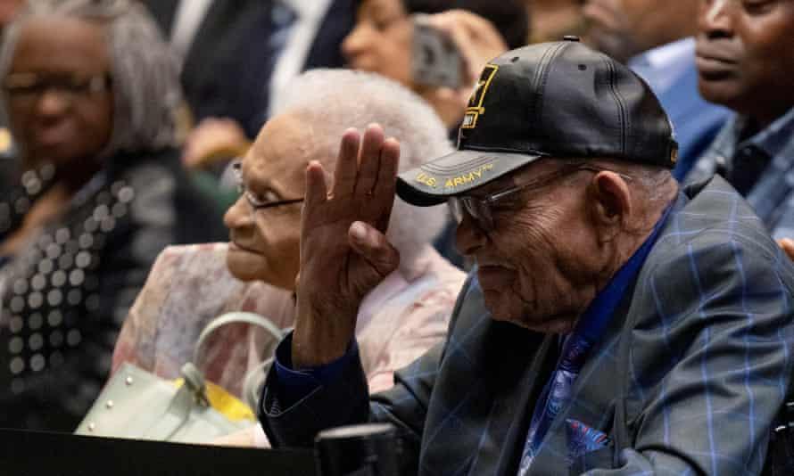 Tulsa race massacre survivor Hughes Van Ellis reacts with a salute as he and fellow survivor Viola Fletcher listen to Joe Biden's speech.