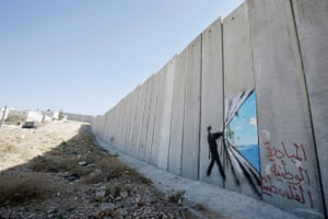 Banksy's artwork is seen on the West Bank barrier in Abu Dis