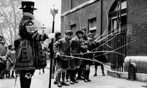 Boys beating the bounds near the Tower of London c1900