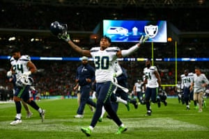 Bradley McDougald of the Seattle Seahawks reacts in front of the fans at half-time.