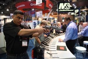 Rene Ramirez checks out a handgun.