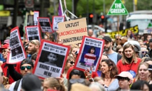 Demonstrators in Melbourne call for refugees on Manus and Nauru to be brought to Australia.
