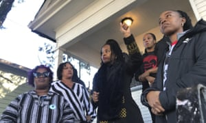 Sharena Thomas, left, Carroll Fife, center, Dominique Walker, second from right, and Tolani King, right, stand outside the home on 10 December.