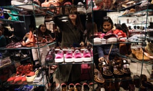 Shoppers look through a collection of shoes during the Boxing Day sale at Selfridges.