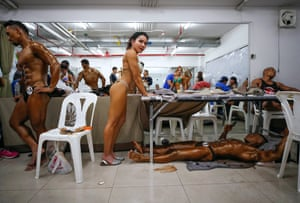 Bangkok, ThailandMale and female bodybuilders prepare backstage to compete during the Asia Pacific Bodybuilding Championships 2019