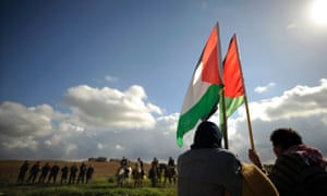 Israeli Arab demonstrators hold Palestinian flags during a protest near the Erez border crossing, where Ghada was reportedly dropped off.