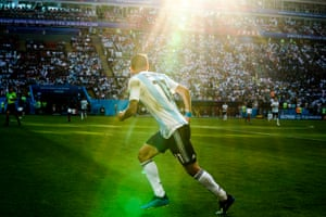 Ángel Di María is illuminated by sunshine during the last-16 match between France and Argentina.