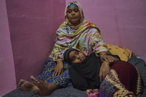 Homeless Somalian refugee Safiya sits with her eight-year-old daughter Sabrine