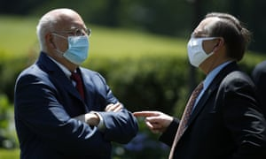 Dr Robert Redfield, director of the Centers for Disease Control and Prevention, left, waits for a press briefing about the coronavirus in the Rose Garden of the White House to begin Friday, 15 May 2020, in Washington.