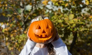 A child takes part in pumpkin carving in the Clore Centre at RHS Garden Wisley