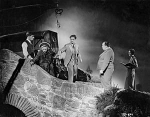The 39 Steps (1935) Hitchcock (second right) directing the handcuffed Madeleine Carroll and Robert Donat on the first day of filming.