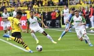 Borussia Dortmund's Jadon Sancho scores his side's second goal in a comfortable 5-1 win over Augsburg.