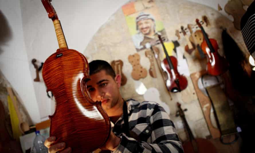 Shehada Shalalda admires a violin in Ramallah.