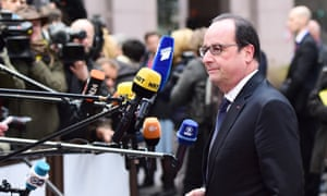 France's President Francois Hollande speaks to the press as he arrives at the European Union headquarters in Brussels.