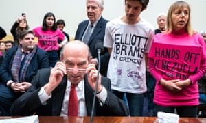 Elliott Abrams is met by protesters as he testifies before the House foreign affairs committee.