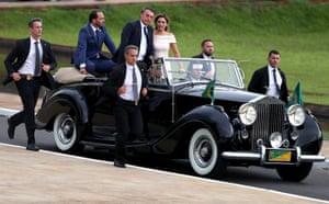 Jair Bolsonaro and his wife in a Rolls-Royce