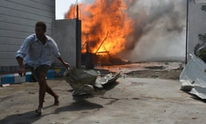A man flees from a petrol station after it was hit by an airstrike in Al Hudaydah, Yemen