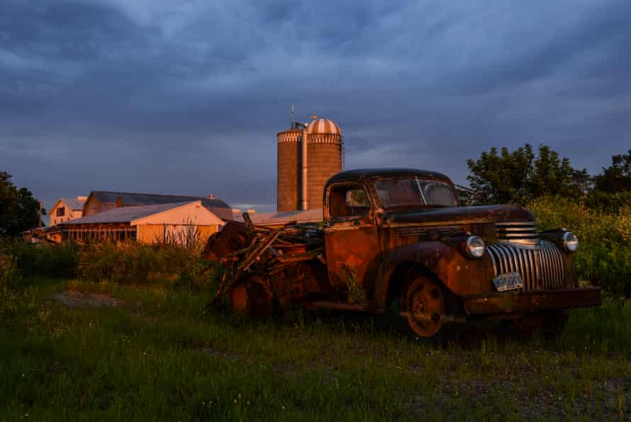 The sun sets on an old farm truck at the Krocak farm in Montgomery, July 2019