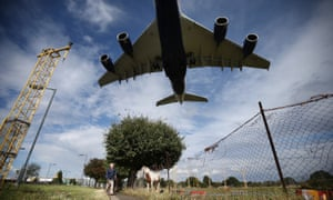 A passenger plane comes over Heathrow airport
