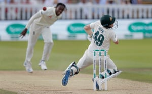 Steve Smith collapses to the ground after being hit in the neck by a ball from Jofra Archer during the second Ashes Test at Lord's