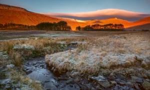 Sunrise hits Pen y Fan in the Brecon Beacons.